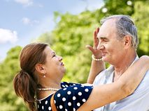 Happy old couple outdoor. Royalty Free Stock Photo