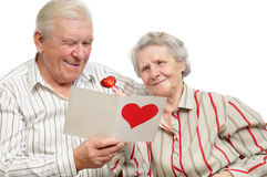 Happy old couple with post-card stock photos