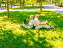 The happy old couple in the summer on a walk Stock Image