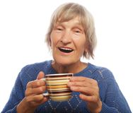 Happy old lady with coffee Royalty Free Stock Photos