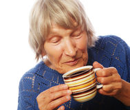 Happy old lady with coffee Royalty Free Stock Photography