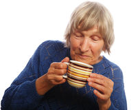 Happy old lady with coffee Royalty Free Stock Images