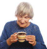Happy old lady with coffee Stock Image