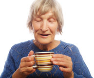 Happy old lady with coffee Royalty Free Stock Image