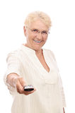 Happy old lady with remote control Royalty Free Stock Image
