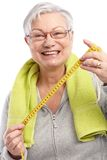 Happy old lady with tape measure Stock Images