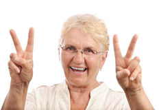 Happy old lady victory sign Stock Photos