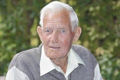 Happy old man. Happy healthy old man outdoors in garden stock photos