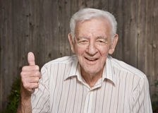 Happy old man. Giving thumbs up