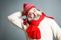 Happy Old Man with Beard in Red Winter Clothes. Portrait of Happy Old Man with Beard in Red and White Winter Clothes on Gray Background. Modern Mature Man Stock Photography