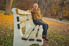 Happy Old Man On Bench Royalty Free Stock Photography