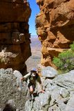 Happy old man climbs. In mountains. Shot in Wolfberg Mountains, Cederberg, Western Cape, South Africa Stock Photo