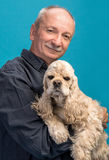 Happy old man with a dog Royalty Free Stock Image