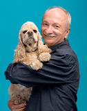 Happy old man with a dog. On a blue background Royalty Free Stock Images