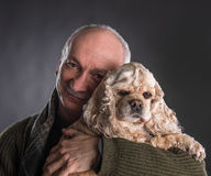 Happy old man with a dog Stock Image