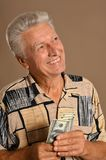 Happy old man. With dollars on background Royalty Free Stock Photography