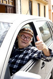 Happy old man driving a car. Driver-senior-elderly - retire-pensioner Royalty Free Stock Photo