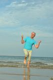 Happy old man  enjoy fresh air on beach Royalty Free Stock Image