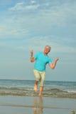 Happy old man  enjoy fresh air on beach. Happy old man enjoy fresh air in summer on beach Royalty Free Stock Image