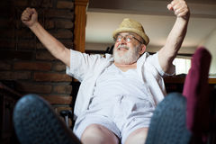Happy old man. With his hands up Stock Images