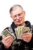 Happy old man holding dollars. Isolated Stock Photos