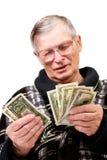 Happy old man holding dollars Stock Photos