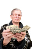 Happy old man holding dollars. Isolated Royalty Free Stock Images
