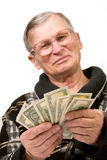 Happy old man holding dollars. Isolated Stock Photography