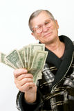 Happy old man holding dollars. Isolated Stock Images