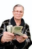 Happy old man holding dollars Stock Image