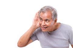 Happy old man listening. White isolated background Royalty Free Stock Image