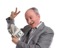 Happy old man with money Royalty Free Stock Photography