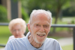 Happy old Man Outside. Portrait of senior man smiling outside during day stock image