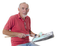 Happy old man preparing to paint with roller Royalty Free Stock Photography