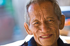 Happy old man smiling. In thailand Stock Image