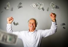 Happy old man in white and falling dollar banknotes. Currency and lottery concept Stock Images