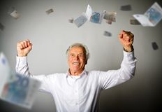 Happy old man in white and falling Euro banknotes. Currency and lottery concept Royalty Free Stock Image