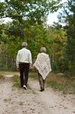 Happy old people. Beautiful happy old people in the autumn park Royalty Free Stock Image