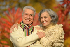 Happy old people. Beautiful happy old people in the autumn park Royalty Free Stock Photography