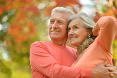 Happy old people. Beautiful happy old people in the autumn park Stock Photo