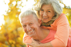 Happy old people. Beautiful happy old people in the autumn park stock photos