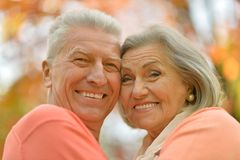 Happy old people. Beautiful happy old people in the autumn park Stock Photography