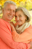 Happy old people. Beautiful happy old people in the autumn park Stock Image