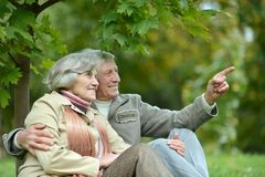 Happy old people. Beautiful happy old people sitting in the autumn park Royalty Free Stock Images