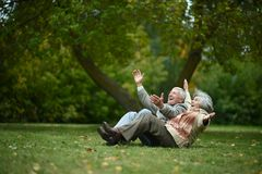 Happy old people. Beautiful happy old people sitting in the autumn park Royalty Free Stock Image