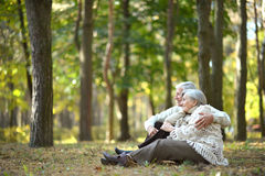 Happy old people. Beautiful happy old people sitting in the autumn park Stock Photo