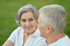 Happy old people. Beautiful happy old people sitting in the summer park Stock Image