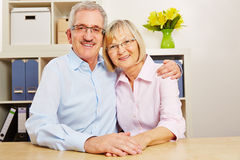 Happy old senior couple at home Stock Images