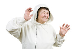 Happy old woman. Dancing in headphones while listening music Royalty Free Stock Photos