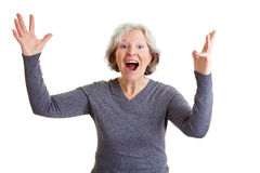 Happy old woman cheering Stock Photo